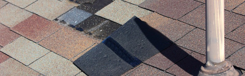 A roof with dislodged shingles