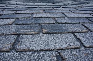Weather-damaged shingle tile roof