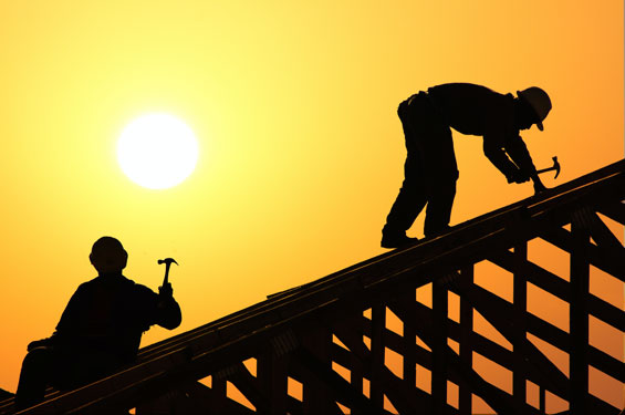 Grand Junction roofing services are building a roof and servicing the roof.